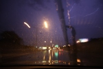 Lightning in sky while driving in downtown Rochester