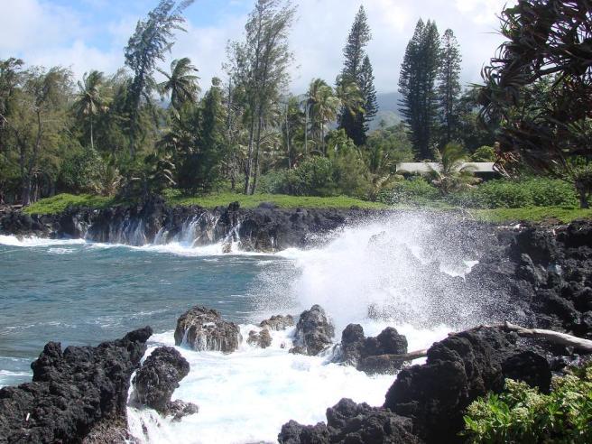 Waves breaking on Lava Rocks